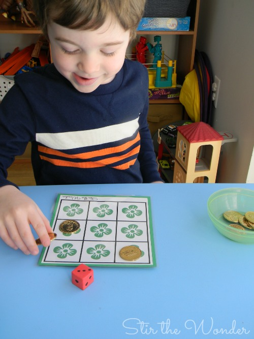 Playing St. Patrick's Day Shamrock Grid Math Game | Stir the Wonder