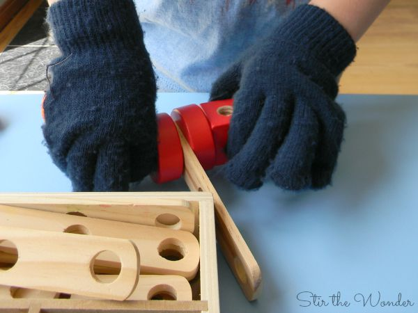 Astronaut Fine Motor Training- building with gloves and construction set