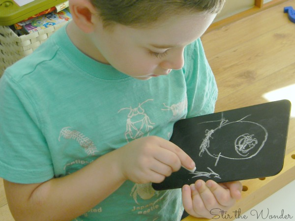 drawing with chalk on small chalkboards is a simple fine motor activity for preschoolers