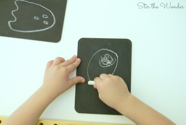 drawing with chalk on mini chalkboards