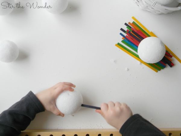 Building snowball sculptures with craft sticks