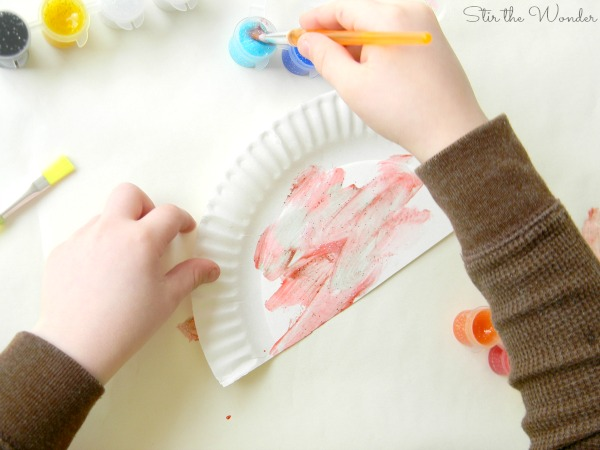 Exploring paint colors with open-ended rainbow art project.