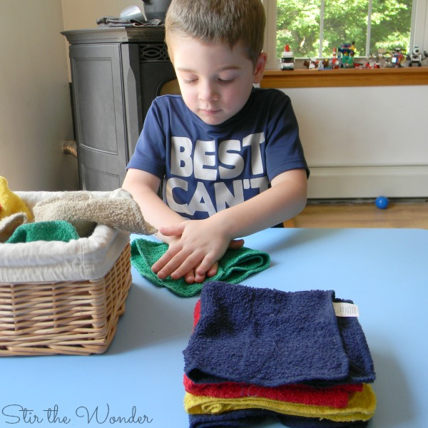 Child folding towels
