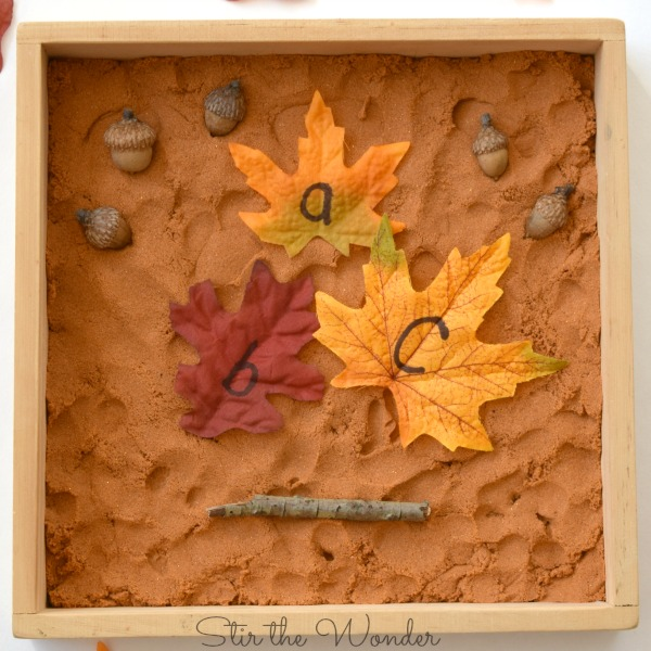 fall kinetic sand writing tray with alphabet leaves