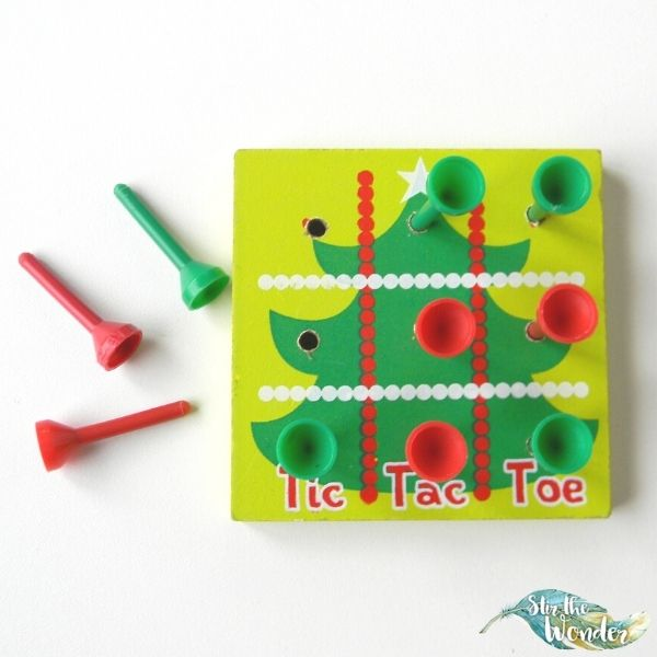Even though youngsters might not be able to play tic-tac-toe they can practice fine motor skills with this Christmas themed golf tee game.