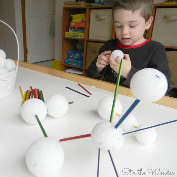 Building sculptures with snowballs and skinny craft sticks