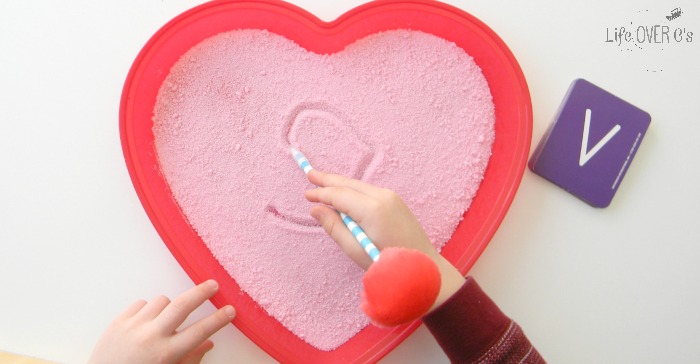 This Valentine's Salt Writing Tray is a fun way to build fine-motor skills and learn how to write the alphabet!