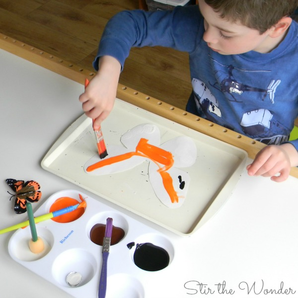 Child painting butterfly