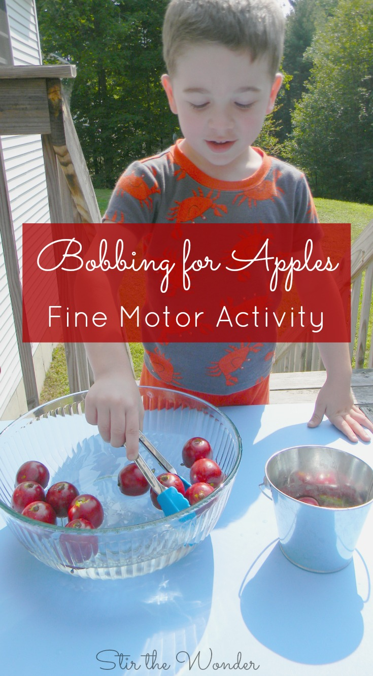 Bobbing for Apples using tongs is a fun sensory activity and fine motor activity for preschoolers!