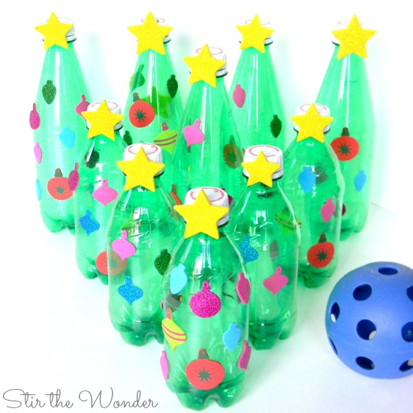 Christmas Tree Bowling is a great game to play at your next kids' holiday party! It's the perfect game to ecourage movement at the classroom, homeschool co-op or family party!