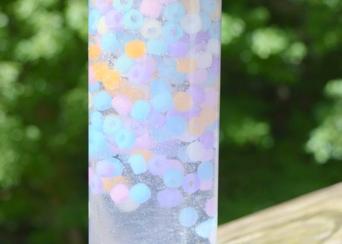 This Magic Color Changing Sensory Bottle is a fun way to teach kids about the power of the sun and the importance of sunscreen!